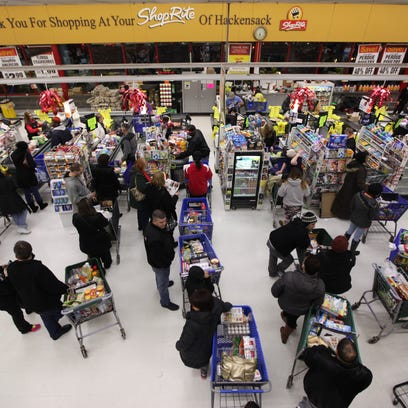 Customers wait in line to check out at ShopRite of