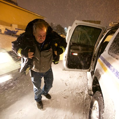 Kevin Devlin puts on a heavier coat as the storm intensified