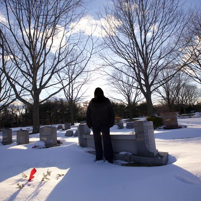Jan stands at her mother's grave. Her mother died after