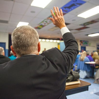 Shelburne Selectboard Chairman Gary von Stange raises