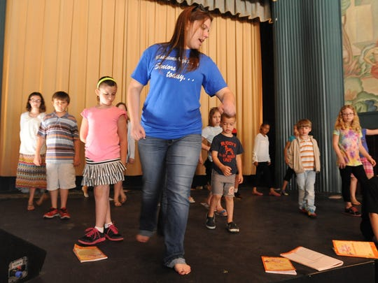 Director Jill Kairis, 18, of Middletown, works with children taking an acting class at the Milton Theater.