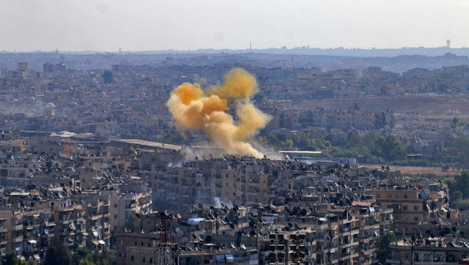 Smoke rises from reported opposition fire from buildings in an eastern government-held neighborhood of the northern Syrian city of Aleppo on Oct. 20, 2016.
