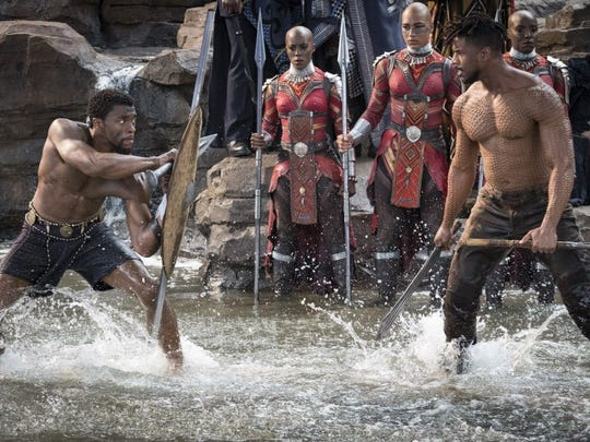 T'Challa/Black Panther (Chadwick Boseman) and Erik Killmonger (Michael B. Jordan) fight it out for the throne in 'Black Panther.'