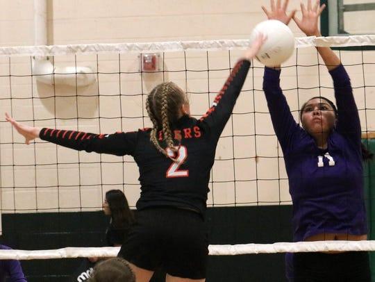 Capitan's Kara Vallance fires a ball at Mescalero's