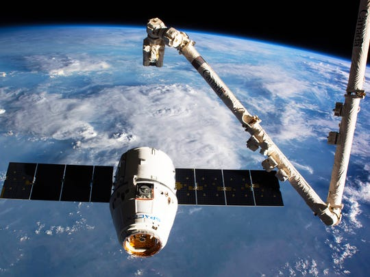 A SpaceX Dragon spacecraft is seen during its final