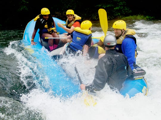 A raft goes down a rapid during a whitewater rafting