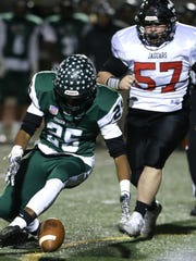 Jah'Kwan Gordon (25) of  Long Branch goes after a Jackson