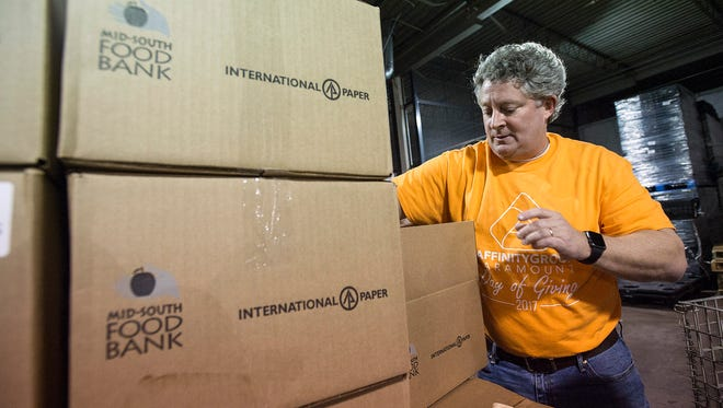 December 19, 2017 - Gary Norbert, a volunteer with Affinity Group Paramount, packs boxes of groceries at the Mid-South Food Bank. International Paper donated the empty cardboard boxes. (Brandon Dill/Special to The Commercial Appeal)