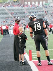 Cancer survivor Mitch Stone on the sidelines back in 2009 with then UC Bearcat Travis Kelce.