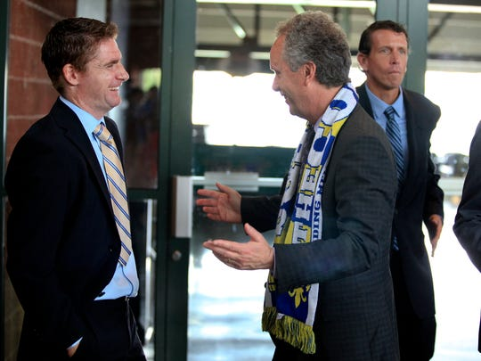Mayor Greg Fischer, right, jokes with Louisville City FC soccer head coach James O'Connor. June 4, 2014