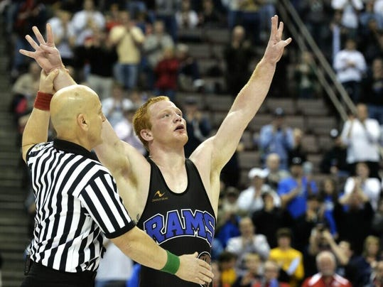Kennard-Dale's Chance Marsteller celebrates after winning his fourth straight PIAA Class AAA wrestling championship Saturday night at Hershey's Giant Center.
