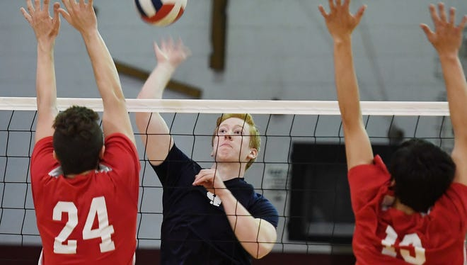 Matt Cohen (4) of Wayne Valley and Connor Field (24) and Greg Huebner (13) of Lakeland were on opposite sides of the net in the Passaic County boys volleyball final. Now their teams are on opposite sides of the North 1 sectional bracket as the top two seeds.