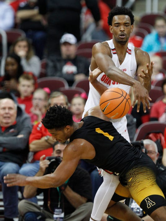 Ohio State forward Keita Bates-Diop, top, blocks a shot by Appalachian State guard Justin Forrest during the second half of an NCAA college basketball game in Columbus, Ohio, Saturday, Dec. 16, 2017. Bates-Diop was called for a foul. (AP Photo/Paul Vernon)
