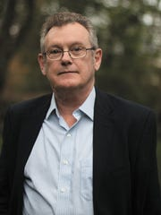 Author Richard F. Thomas.