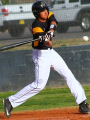 Josh Caraway swings at a ball Tuesday evening at Tiger Field. Mayfield swept Alamogordo in a doubleheader 6-4 and 8-0.