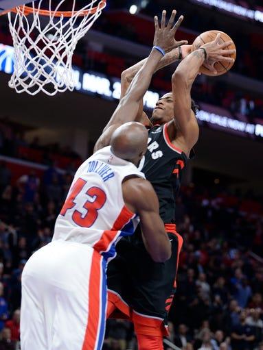 Raptors' DeMar DeRozan dunks on Pistons' Anthony Tolliver