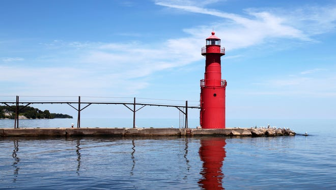 The Algoma Pierhead Lighthouse was installed in 1932 to replace an older square lighthouse.