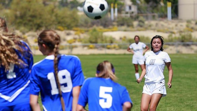 Piedra Vista's Natalie Flores scores against Bosque on Saturday at the Piedra Vista soccer fields.