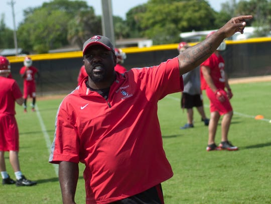 North Fort Myers head coach Earnest Graham coaches