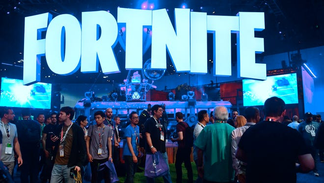 A display area for the online survival game Fortnite, which has become a top-grossing game -- even though it's free to download -- because its 125 million players are buying outfits, dance moves and other social features to make the game more fun.