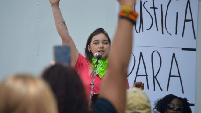Lily Harmon, one of the organizers of the Black Lives Matter rally Sunday, June 7, speaks to the estimated crowd of 3,000 supporters before marching to the Unity Bridge.