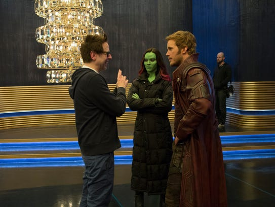 Director James Gunn (left) goes over a scene with Zoe