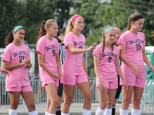 The Dallastown girls' soccer team sports pink jerseys