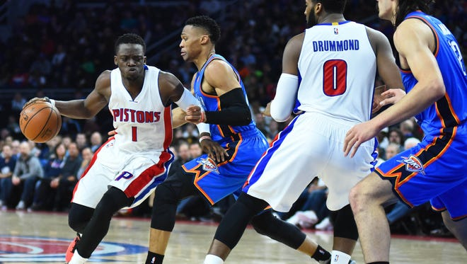 Detroit Pistons guard Reggie Jackson (1) dribbles the ball as Oklahoma City Thunder guard Russell Westbrook (0) defends during the fourth quarter at The Palace of Auburn Hills.