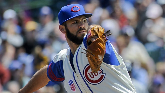 """Jake Arrieta says his """"hand position at release point"""" creates the devastating rotation on his cut fastball."""