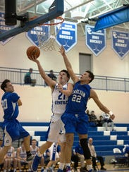 Catholic Central's C.J. Baird goes in for the layup