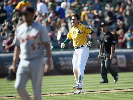 Ryon Healy of the Oakland Athletics reacts as he runs