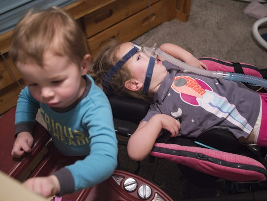 Elke and her brother AJ, 2, play at their Fort Collins