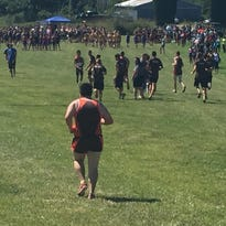 "Teammates from Northrop High School raced ahead of Jacob Miller after lining the course to help him finish his first junior varsity cross country meet Saturday at the Huntington North Invitational. Miller finished last, but his coach said, ""We are pumped,"" for a run that turned into a team effort."