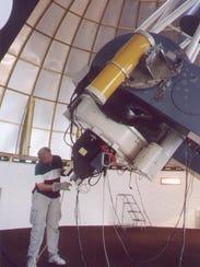 Bill Keel fills the instrument tank with liquid nitrogen