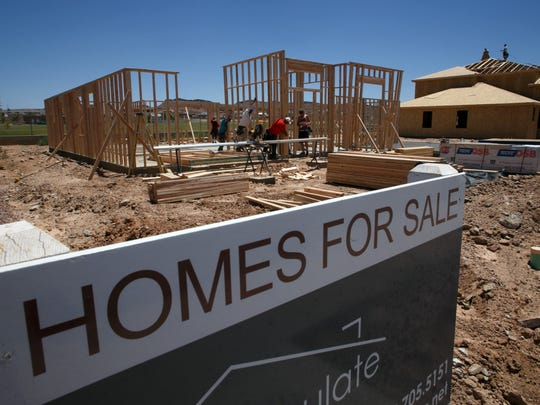Framing work continues on a pair of homes in Little Valley on June 30.