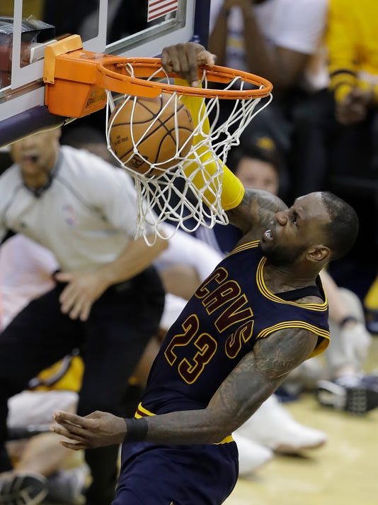 FILE - In this April 20, 2017, file photo, Cleveland Cavaliers' LeBron James dunks during the second half in Game 3 of the team's first-round NBA basketball playoff series against the Indiana Pacers, in Indianapolis. At 32, James shows no signs of age or slowing down. After leading the NBA in minutes per game during the regular season, he averaged 43.7 in Cleveland's first-round sweep of Indiana, all but debunking the theory he needs rest. He'll get some this week as the Cavs await the Toronto-Milwaukee winner. (AP Photo/Darron Cummings, File)