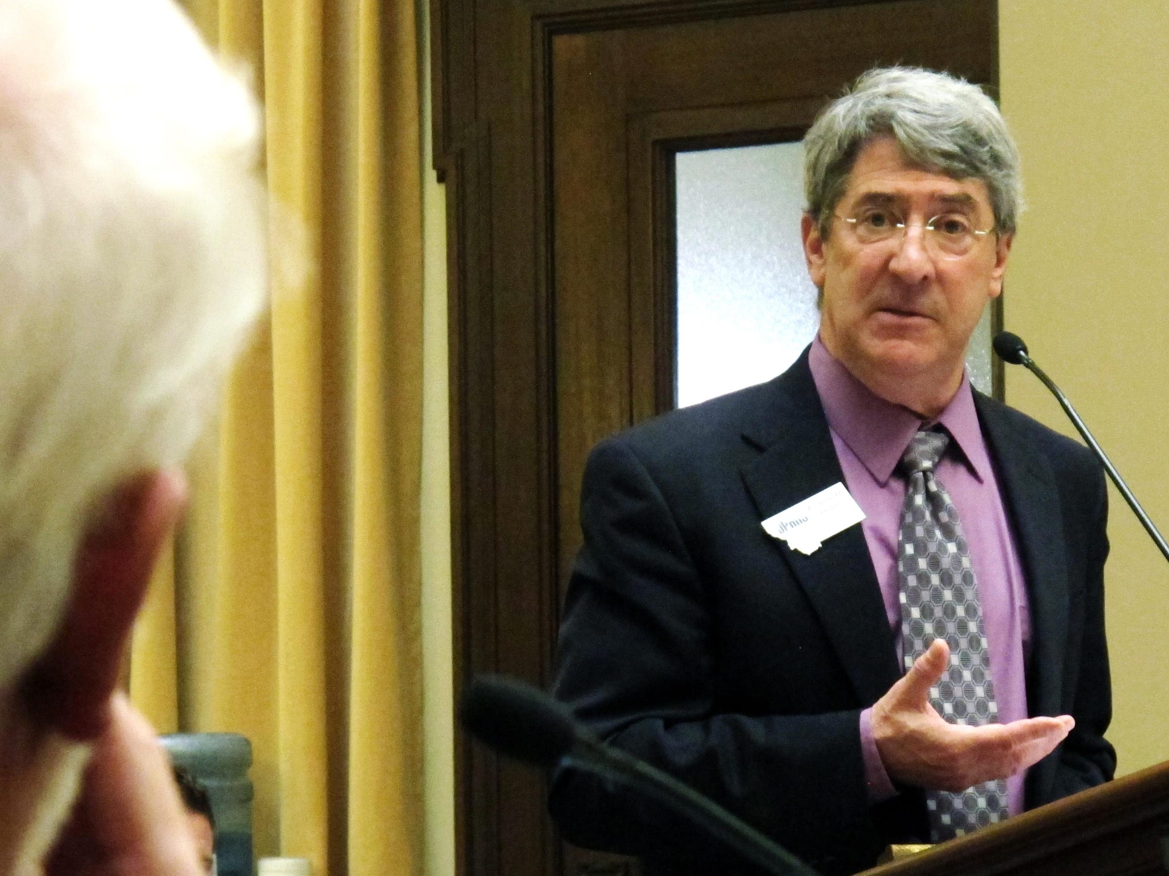 Department of Public Health and Human Services Director Richard Opper discusses budget issues in Helena on April 4, 2013.