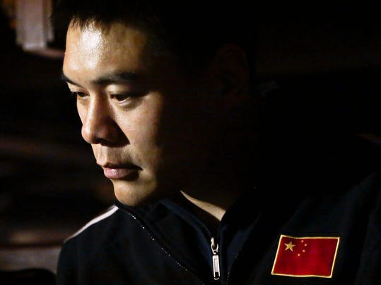 """Chinese Boxer Zhang Zhilei, a 2008 Beijing Olympics silver medalist, listens during his introduction at a press conference, Monday March 10, 2014 in New York.  Zhang's introduction coincided with the launch of Dino Duva's promotional boxing venture """"Dynasty,"""" partnered with brothers Tommy and Terry Lane, sons of Hall of Fame boxing referee Mills Lane. Zhang will be the first fighter promoted by """"Dynasty."""" (AP Photo/Bebeto Matthews)"""