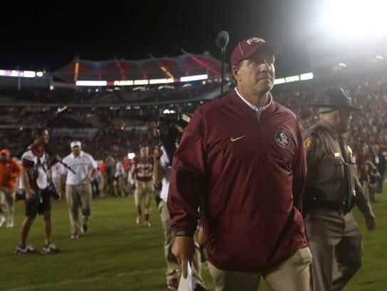 FSU Head Coach Jimbo Fisher walks off the field after