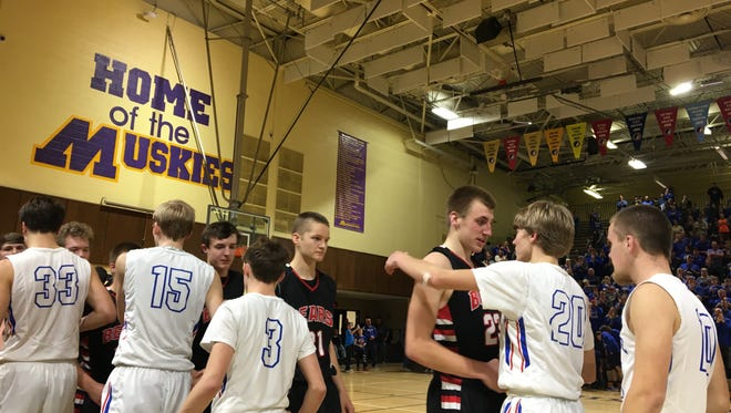 West Branch players shake hands with Camanche players after losing the substate final on Feb. 25, 2017.