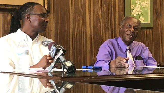At left, Rodney Jones, president of the NAACP chapter in Pensacola, and activist H. K. Matthews address racial profiling concerns about a Milton drive-by shooting during a press conference Tuesday, April 18, 2017, at the NAACP's headquarters in Pensacola.