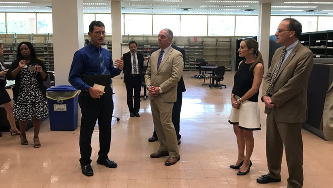 Gov. John Bel Edwards and lawmakers toured the LSU library Thursday.
