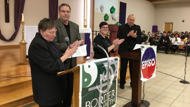 Organizers with EPISO and Border Interfaith applaud during an accountability session.