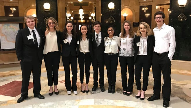 The D.C. Everest mock trial team of Adam Peterson, Alexyss Schulz, Libby Radies, Felysity Cha, Jordan Sazama, CJ Caraos, Samantha Baltzell, Shea Johnson and Michael Knoll finished second at the state tournament.