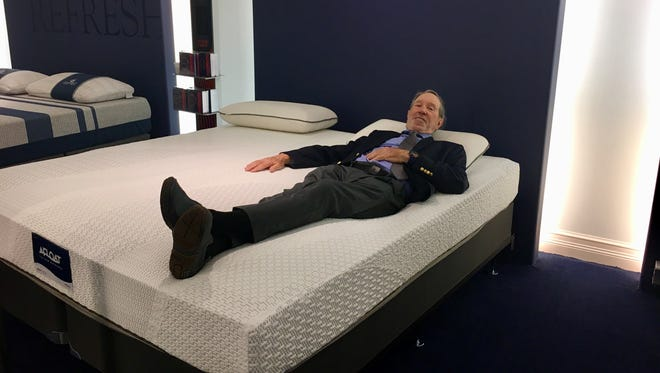 Charles Hall, the inventor of the waterbed, lies down on one of his new Afloat waterbeds in City Furniture's Fort Myers location.