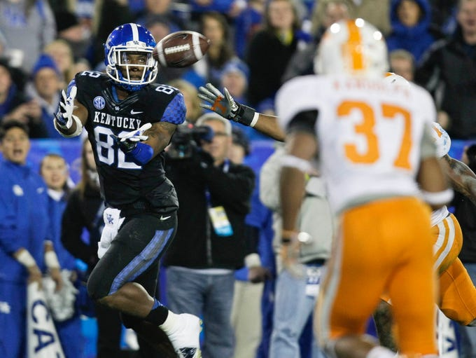 Kentucky tight end Anthony Kendrick catches this pass in the second quarter to give the Wildcats their first touchdown. It was Kendrick's first career touchdown.