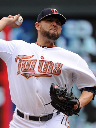 Twins pitcher Ricky Nolasco delivers a pitch during