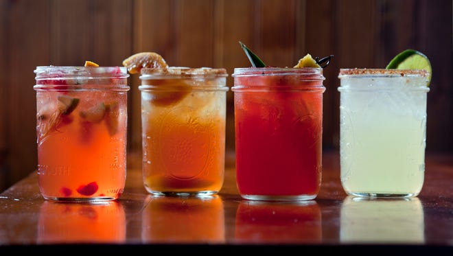 Featured moonshine drinks, from left, Stillhouse Sangria, Fire and Ice Tea, Shiners Punch and In-famous Margherita at Famous Dave's, Friday, Sept. 20, 2013 in Cherry Hill, N.J.