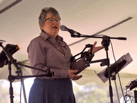 Marty CashBurless, the McMurry University chaplain, addresses students during chapel Tuesday. McMurry held the gathering under a tent and served lunch afterward.