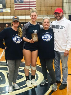 Kaitlyn Haller, second from left, poses with her mother Jennifer Zeller, grandmother Sandra Zeller and father Jon Zeller after receiving an all-region plaque for her play with Metropolitan Community College last fall. Haller, a Blue Springs graduate, will move on to play for Ottawa University in Kansas this fall.